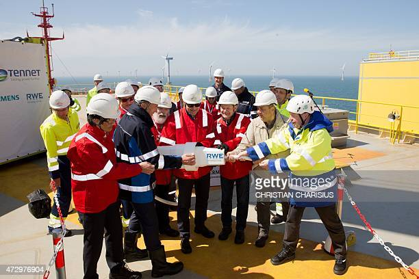 Japan's vice economy minister Shigeki Iwai IRENA director general Adnan Z Amin Tennet Holding B V chairman Mel Kroon EU Commissioner for Energy and...