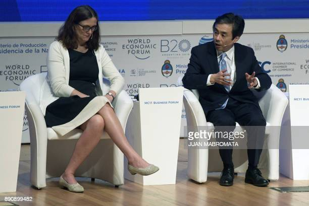 Japan's ViceMinister for International Affairs Tadao Yanase talks next to EU Trade Commissioner Cecilia Malmstrom during a plenary session of the...