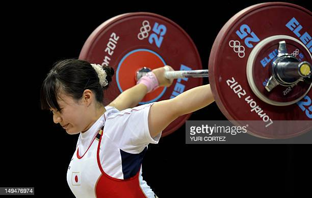 Japan's Yagi Kanae fails to lift the weight during the weightlifting women's 53kg group B at the Excel Center in London during the 2012 London...