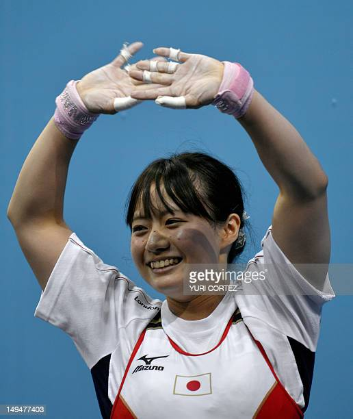 Japan's Yagi Kanae waves during the weightlifting women's 53kg group B competion at the Excel Center in London during the 2012 London Olympic Games...