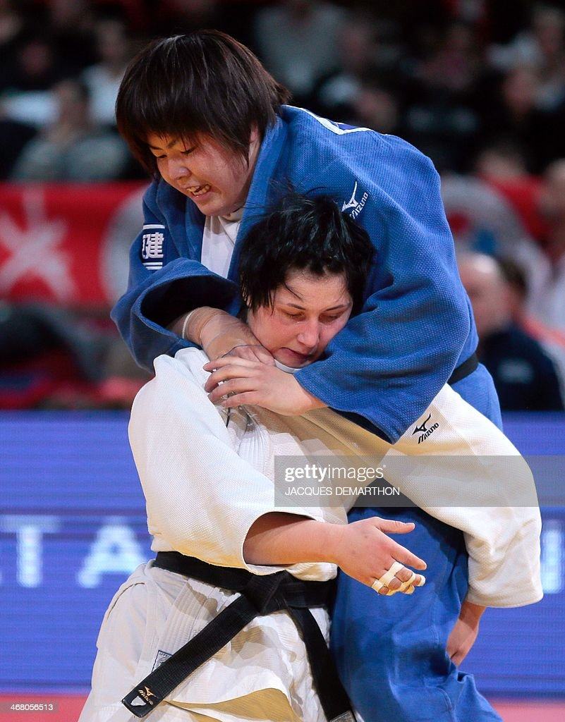 Japan's Yamabe Kanae and Slovenia's Lucija Polavder compete during the women's 78kg quarterfinals at the 2014 Paris Judo Grand Slam tournament on...