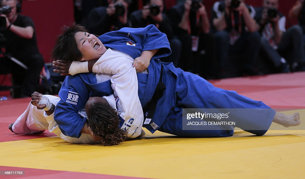 Japan's Yamabe Kanae reacts after winning against France's Emilie Andeol during the women's 78kg final at the 2014 Paris Judo Grand Slam tournament...