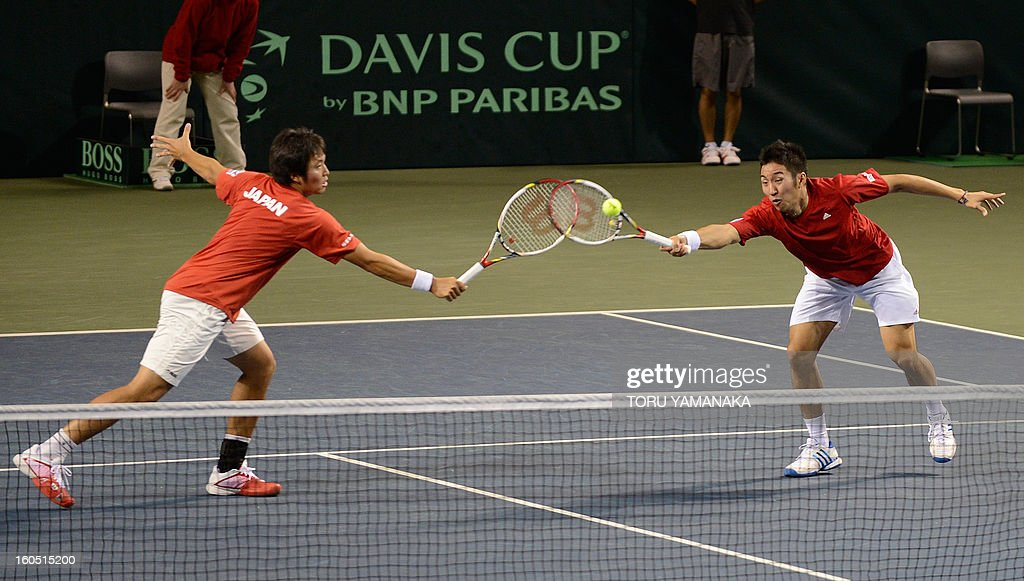 Japan's Yasutaka Uchiyama (R) and his partner Tatsuma Ito (L) try to return a shot to Indonesia's Christopher Rungkat and Elbert Sie during their men's doubles tennis match at the Davis Cup Asia-Oceania Zone Group I first-round tie on February 2, 2013. AFP PHOTO/Toru YAMANAKA