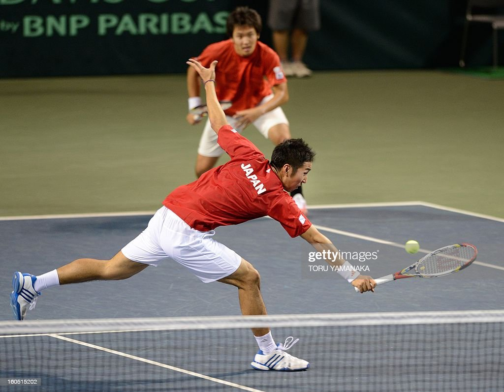 Japan's Yasutaka Uchiyama (front) returns a shot beside his partner Tatsuma Ito (top) to Indonesia's Christopher Rungkat and Elbert Sie during their men's doubles tennis match at the Davis Cup Asia-Oceania Zone Group I first-round tie on February 2, 2013. AFP PHOTO/Toru YAMANAKA