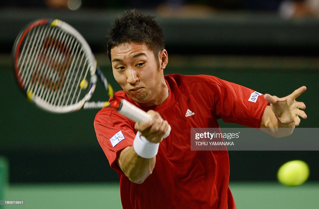 Japan's Yasutaka Uchiyama returns a shot to Indonesia's Wisnu Adi Nugroho during their men's singles match at the Davis Cup Asia-Oceania Zone Group I first-round tie in Tokyo on February 3, 2013. AFP PHOTO/Toru YAMANAKA