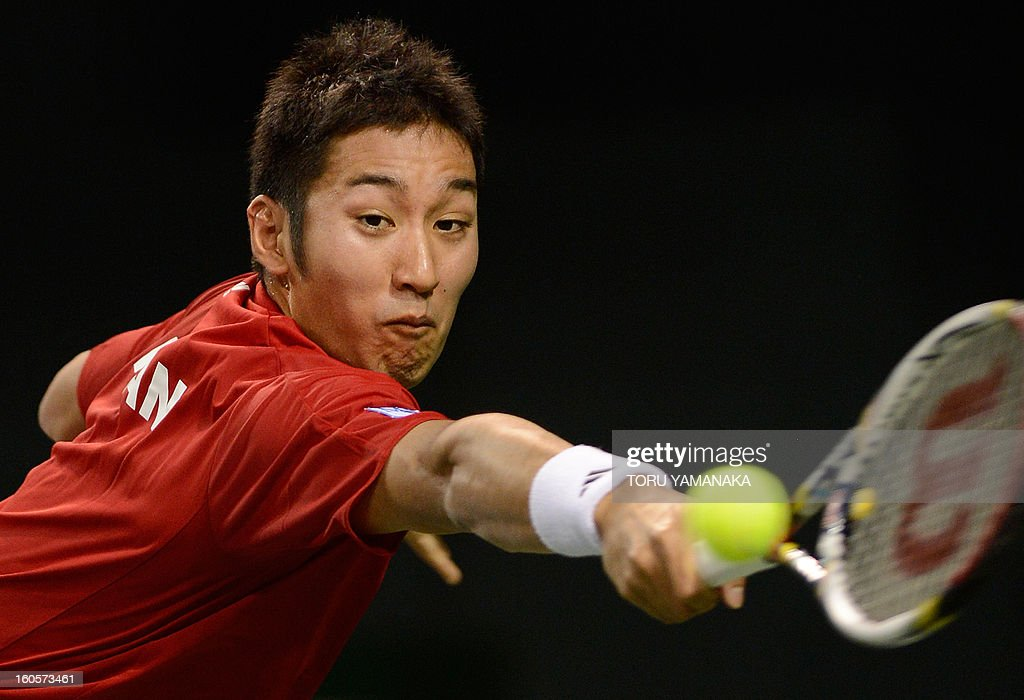 Japan's Yasutaka Uchiyama stretches for the ball from Indonesia's Wisnu Adi Nugroho during their men's singles tennis match at the Davis Cup Asia-Oceania Zone Group I first-round tie in Tokyo on February 3, 2013. AFP PHOTO/Toru YAMANAKA