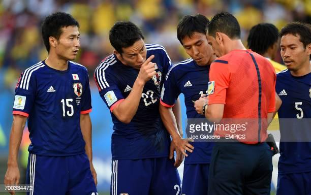 Japan's Yasuyuki Konno Japan's Maya Yoshida and Japan's Makoto Hasebe react to a penalty decision made by referee Pedro Proenca