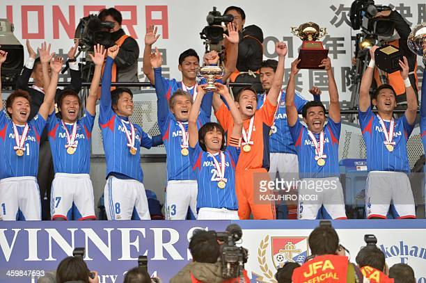 Japan's Yokohama F Marinos captain ShunShunsuke Nakamura and his teammates celebrate their victory over Sanfrecce Hiroshima during the awards...