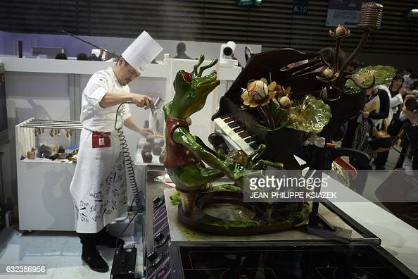 Japan's Yoshiaki Uezaki competes during the Pastries World Cup final on January 22 2017 in Chassieu outside Lyon as part of the Catering and Food...