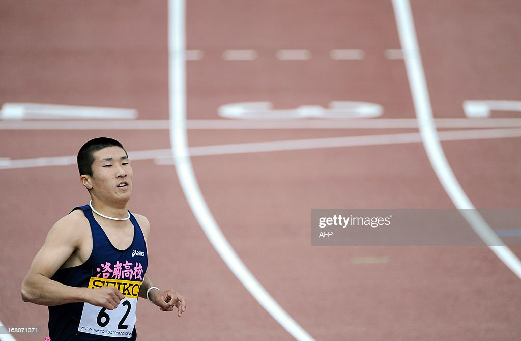 Japan's Yoshihide Kiryu crosses the finish line in the men's 100 metre race during the Seiko Golden Grand Prix in Tokyo on May 5, 2013. Kiryu finished in third place in 10.40 seconds. AFP PHOTO/Rie ISHII