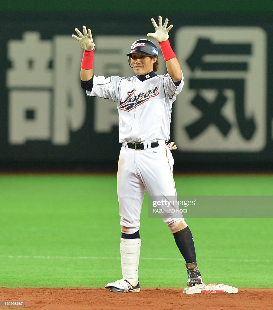 Japan's Yoshio Itoi reacts after scoring against China during the fifth inning of the World Baseball Classic firstround game in Pool A in Fukuoka on...