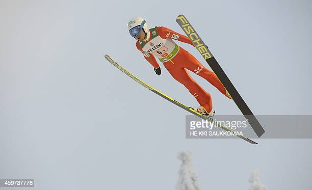 Japan's Yoshito Watabe soars through the air during the Nordic Combined team sprint's ski jumping competition at the FIS World Cup Ruka Nordic...