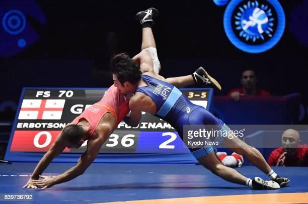 Japan's Yuhi Fujinami defeats Georgian Zurabi Erbotsonashvili to win a bronze medal in the men's 70kilogram freestyle competition at the world...