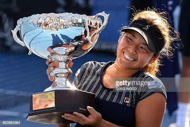 Japan's Yui Kamiji celebrates with the championship trophy after her victory in the women's singles wheelchair final against Jiske Griffioen of the...