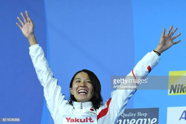 Japan's Yui Ohashi celebrates on the podium after the women's 200m Individual Medley final during the swimming competition at the 2017 FINA World...