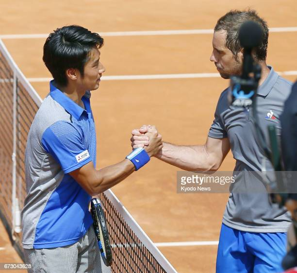 Japan's Yuichi Sugita and Richard Gasquet of France shake hands after their secondround match of the Barcelona Open on April 25 2017 Sugita won 46 63...