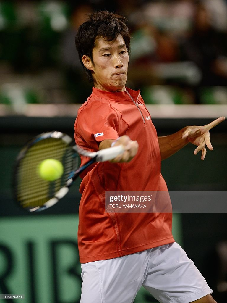 Japan's Yuichi Sugita returns a shot against Indonesia's Christopher Rungkat during their men's singles match at the Davis Cup Asia-Oceania Zone Group I first-round tie tennis tournement in Tokyo on February 3, 2013. AFP PHOTO/Toru YAMANAKA