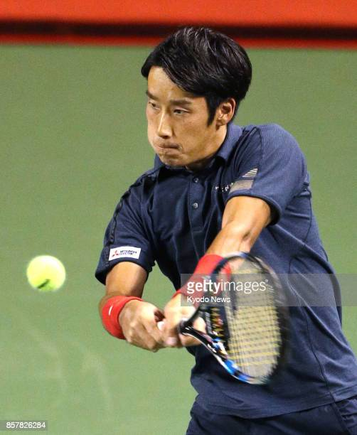Japan's Yuichi Sugita returns a shot to Milos Raonic of Canada during a Japan Open secondround match at Tokyo's Ariake Tennis Forest Park on Oct 5...