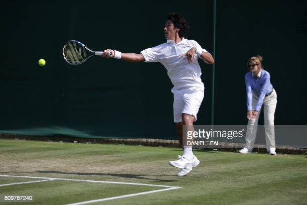 Japan's Yuichi Sugita returns against France's Adrian Mannarino during their men's singles second round match on the fourth day of the 2017 Wimbledon...