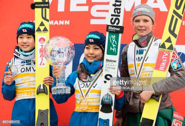 Japan's Yuki Ito Sara Takanashi and Norway's Maren Lundby pose with their trophies during the winner's ceremony of the overall winner of the ski...