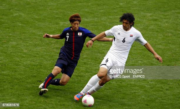Japan's Yuki Otsu battles for possesion with Egypt's Ahmed Hegazi during Men's Quarter Final match at Old Trafford Manchester