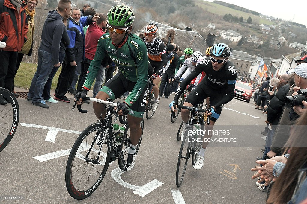 Japan's Yukiya Arashiro of the Europcar team and GreatBritain's Christopher Froome of Sky Procycling team ride during the 99th edition of the...