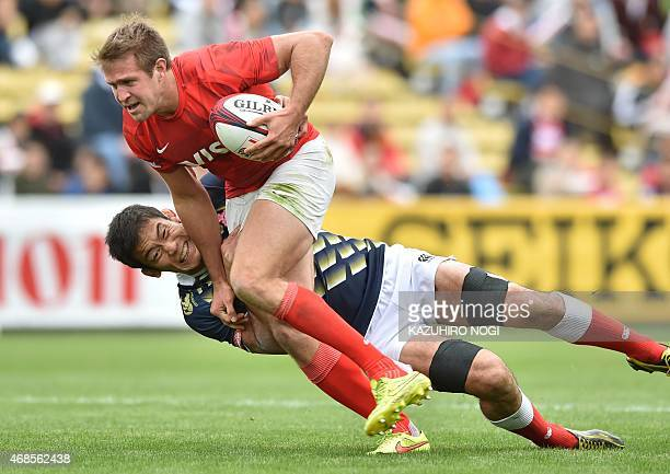 Japan's Yusaku Kuwazuru tackles Argentina's Fernando Luna during their match at the Tokyo Rugby Sevens in Tokyo on April 4 2015 Argentina and Japan...