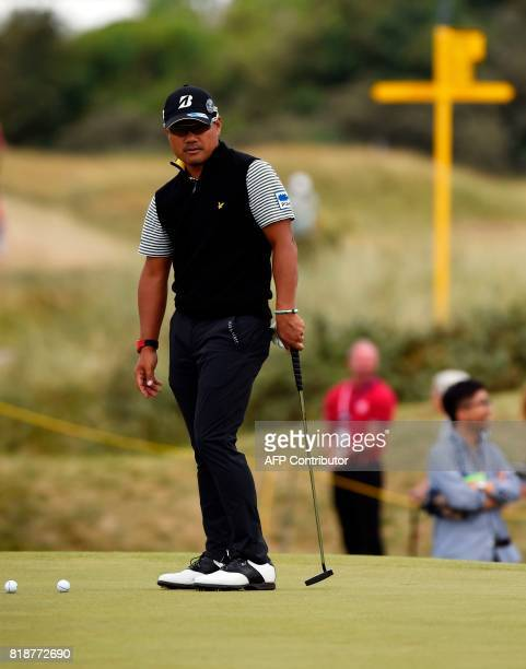 Japan's Yusaku Miyazato stands on the 9th green during a practice round at Royal Birkdale golf course near Southport in north west England on July 19...
