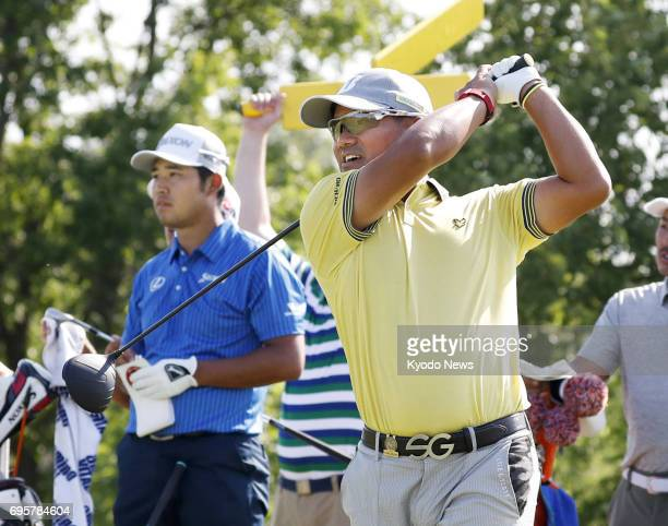 Japan's Yusaku Miyazato takes part in a practice round with compatriot Hideki Matsuyama at Erin Hills in Erin Wisconsin on June 13 two days before...