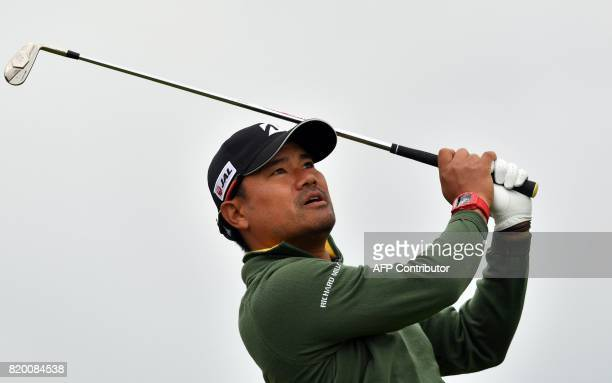 Japan's Yusaku Miyazato watches his iron shot from the 4th tee during his second round on day two of the Open Golf Championship at Royal Birkdale...