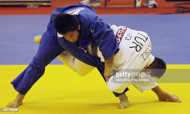 Japan's Yusuke Kanamaru fights with Turkey's Sezer Huysuz during the men's 73kg category during the third day of the 25th World Judo Championship in...