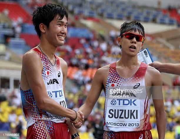 Japan's Yusuke Suzuki and Japan's Takumi Saito shake hands after the men's 20 kilometres walk final at the 2013 IAAF World Championships at the...