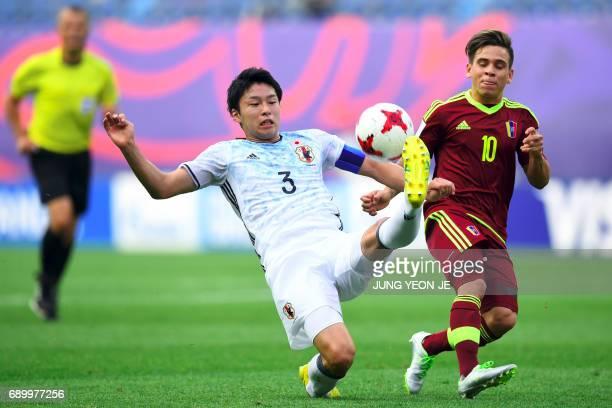 Japan's Yuta Nakayama fights for the ball with Venezuela's Yeferson Soteldo during their U20 World Cup round of 16 football match between Venezuela...