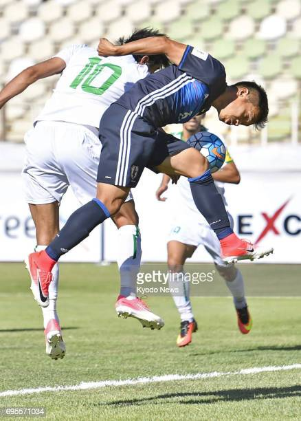 Japan's Yuto Nagatomo and Iraq's Alaa Abdul Zahra vie for the ball in the first half of a World Cup qualifier in Tehran Iran on June 13 2017 ==Kyodo