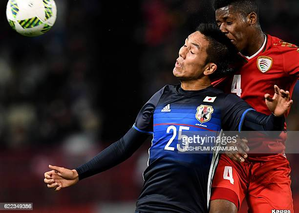 Japan's Yuya Kubo fights for the ball with Oman's Nadir Awadh Bait Mabrook during their football friendly match in Kashima Ibaraki prefecture on...