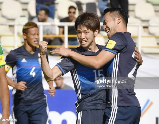 Japan's Yuya Osako is congratulated by teammates after scoring in the first half of a World Cup qualifier against Iraq in Tehran Iran on June 13 2017...
