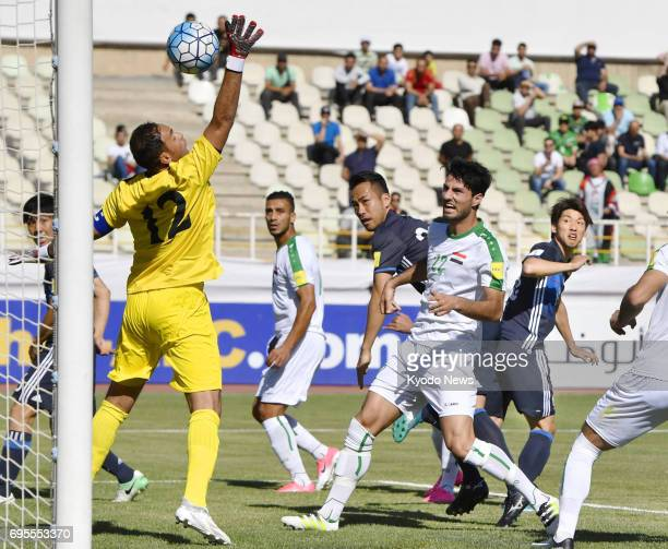 Japan's Yuya Osako scores a header in the first half of a World Cup qualifier against Iraq in Tehran Iran on June 13 2017 ==Kyodo