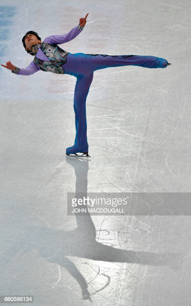 Japan's Yuzuru Hanyu currently ranked fifth competes in the men's short program at the ISU World Figure Skating Championships in Helsinki Finland on...