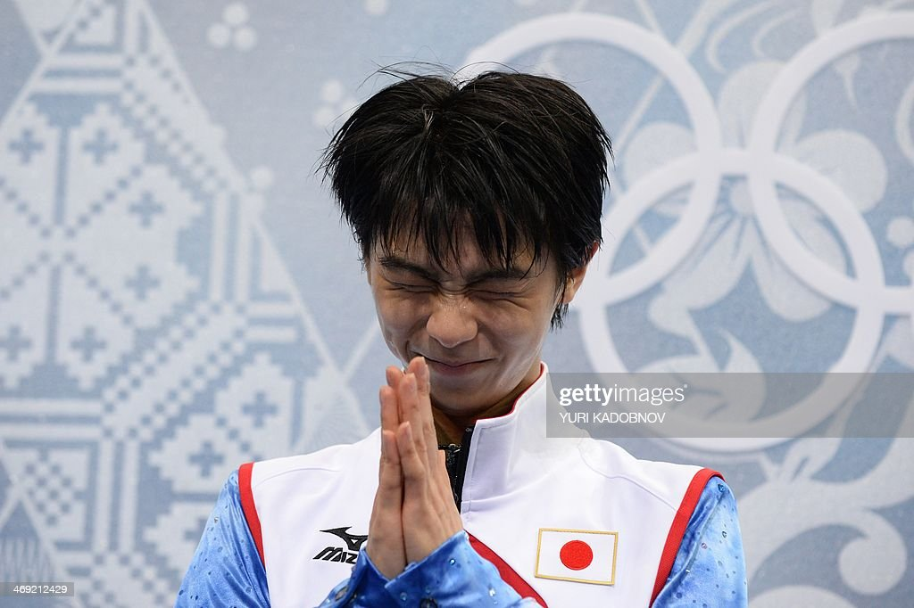 Japan's Yuzuru Hanyu gestures in the kiss and cry zone during the Men's Figure Skating Short Program at the Iceberg Skating Palace during the Sochi Winter Olympics on February 13, 2014.