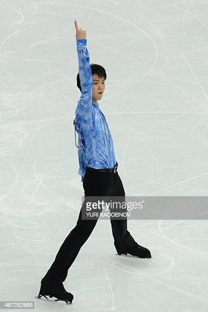 Japan's Yuzuru Hanyu performs in the Men's Figure Skating Team Short Program at the Iceberg Skating Palace during the Sochi Winter Olympics on...