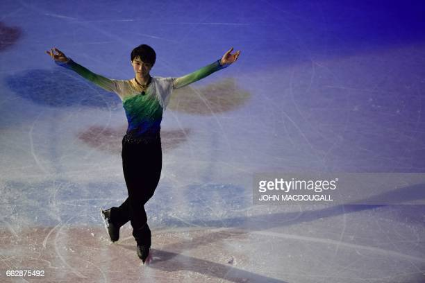 Japan's Yuzuru Hanyu reacts after the men's free skating program at the ISU World Figure Skating Championships 2017 in Helsinki on April 1 2017 / AFP...