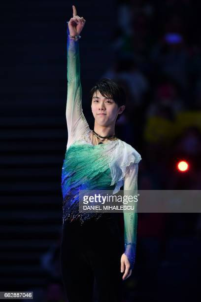 TOPSHOT Japan's Yuzuru Hanyu reacts on the podium after winning the men's free skating program at the ISU World Figure Skating Championships 2017 in...