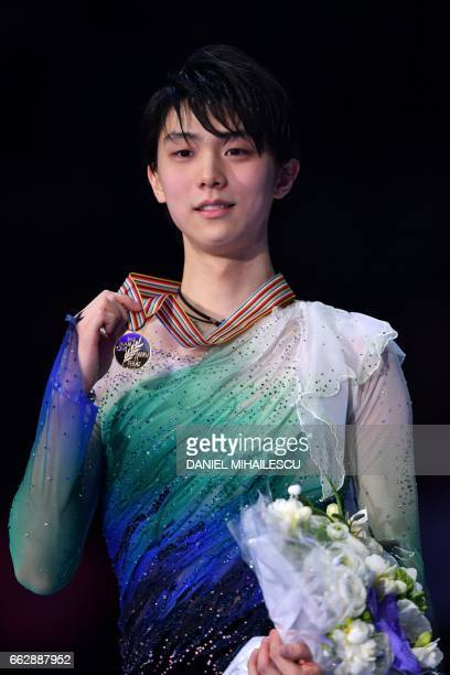 Japan's Yuzuru Hanyu reacts on the podium after winning the men's free skating program at the ISU World Figure Skating Championships 2017 in Helsinki...