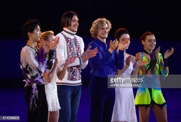 Japan's Yuzuru Hanyu Russia's Tatiana Volosozhar Russia's Maxim Trankov US Charlie White US Meryl Davis and Russia's Adelina Sotnikova pose for...