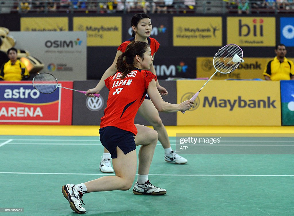 Japans's Misaki Matsutomo (front) hits a shot as partner Ayaka Takahashi looks on as they play against Singapore's Shinta Mulia Sari and Lei Yao during their woman's doubles semi-finals match at the Malaysia Open Badminton Superseries in Kuala Lumpur on January 19, 2013.