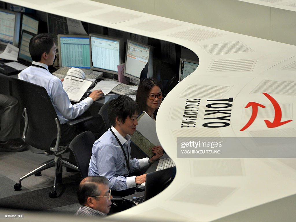 JapanstockseconomyFOCUS by Shingo ITO This picture taken on October 25 2013 shows operators at the Tokyo Stock Exchange monitoring the trading in...