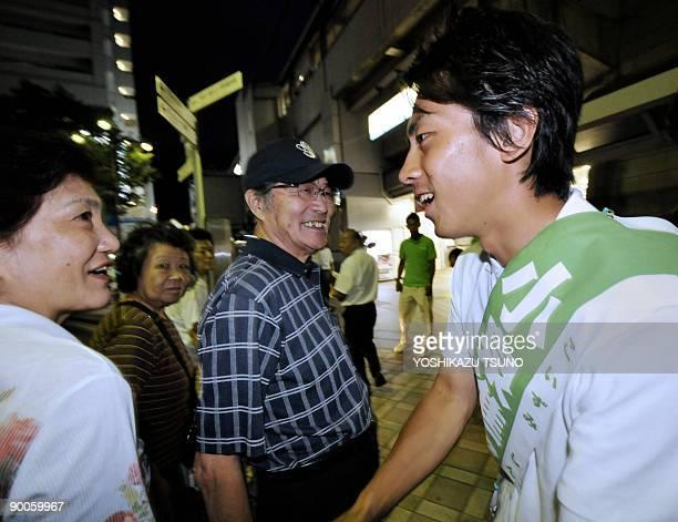 JapanvotedynastiesFOCUS by Kyoko Hasegawa Shinjiro Koizumi the son of charismatic former premier Junichiro Koizumi shakes hands with his supporters...