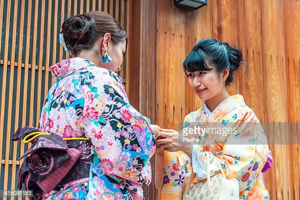 Japenese Girls in Kimono exchange business cards,Kyoto,Japan