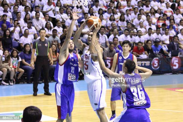 Japeth Aguilar of the Philippines draws defenders Wutipong Dasom and Patiphan Klahan while attempting a driving layup Philippines drubs Thailand...