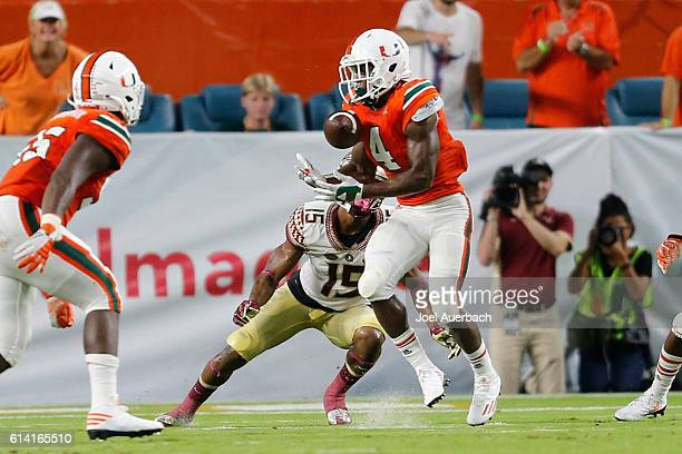 Jaquan Johnson of the Miami Hurricanes intercepts the pass intended for Travis Rudolph of the Florida State Seminoles during second quarter action on...